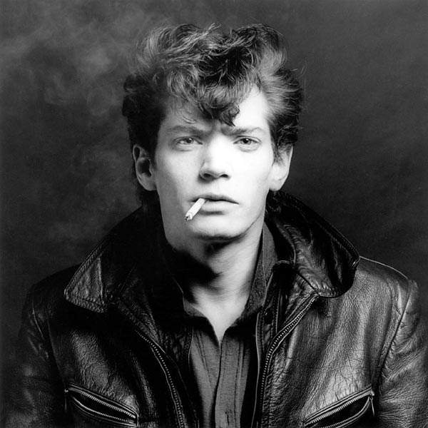 © Robert Mapplethorpe Foundation. If I violated any rules by using this photo I apologize in advance and will delete all of it when contacted. I do not intend to shock anyone with its content; it's merely used to support my piece. Self Portrait of Robert Mapplethorpe.
